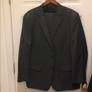 Geoffrey Beene gently worn dark gray suit